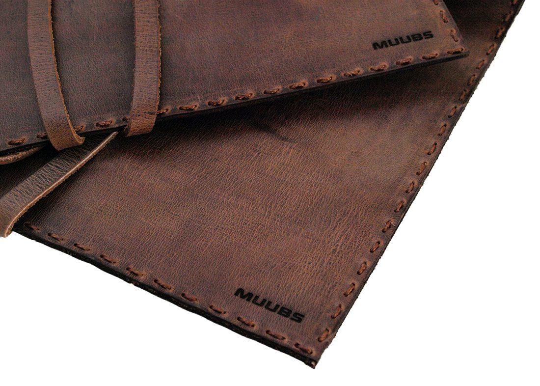 Mapper i læder med Muubs logo